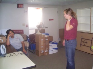 Zaire and Meredith taking a break to figure out office furniture placement